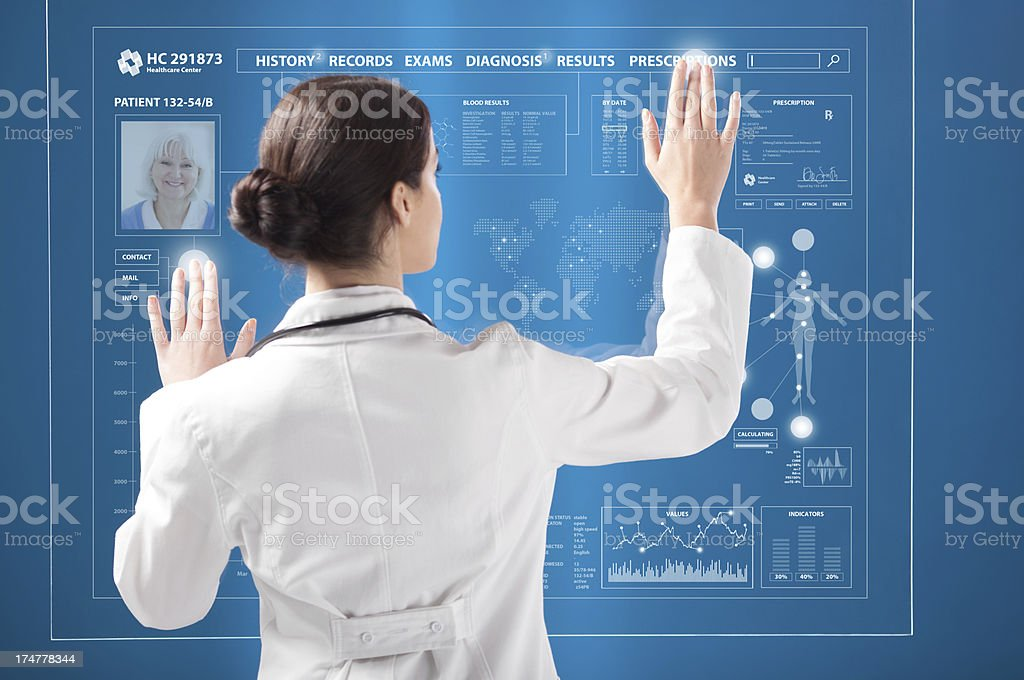 Female doctor working on transparent monitor. royalty-free stock photo