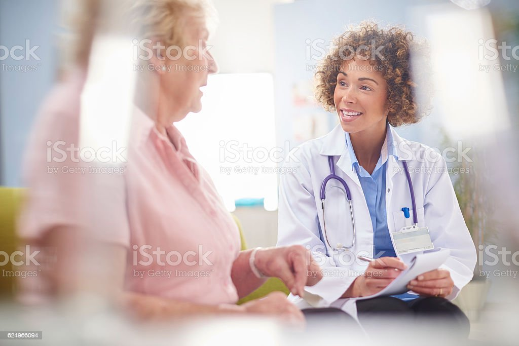 female doctor writing a prescription stock photo