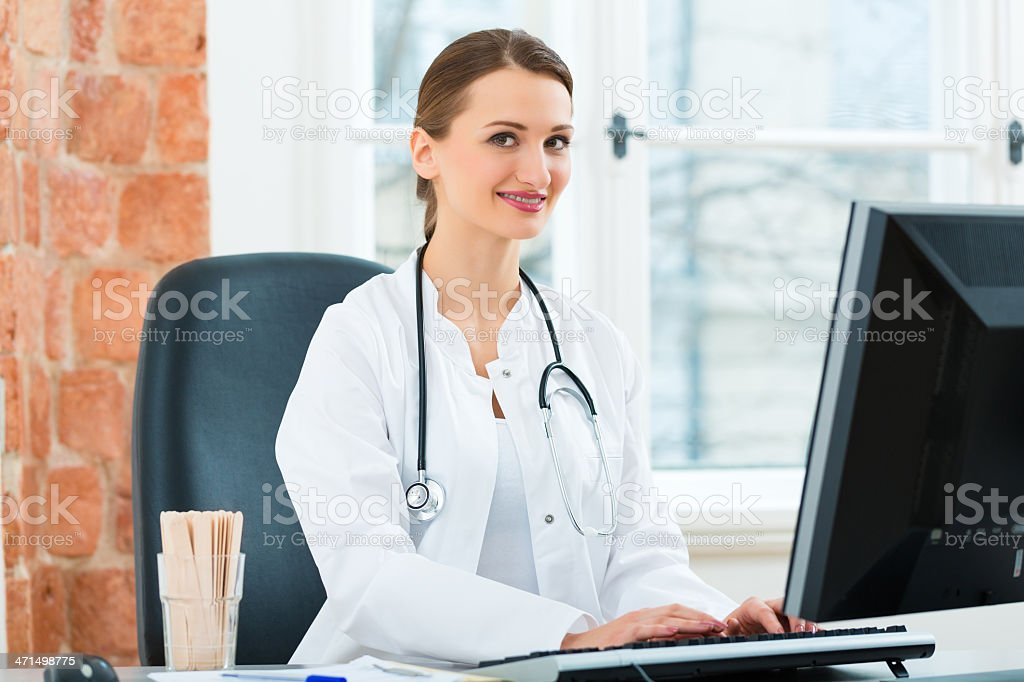 Female doctor writing in document royalty-free stock photo