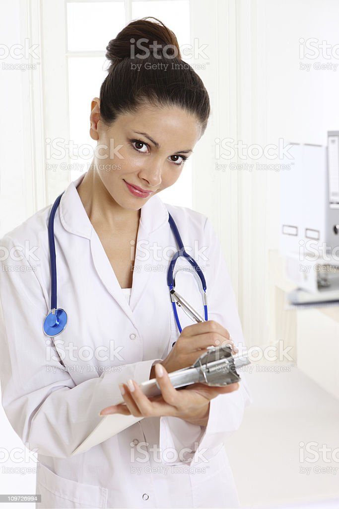 Female Doctor Writing on Charts royalty-free stock photo