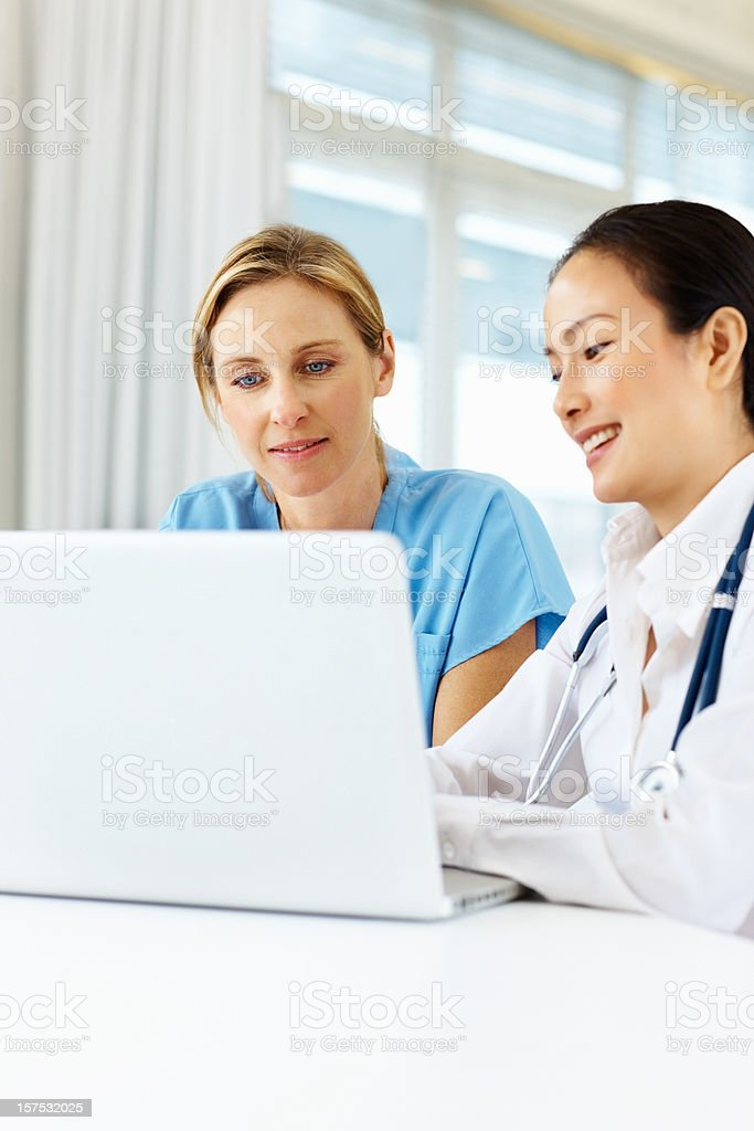 Female doctors working on a laptop royalty-free stock photo
