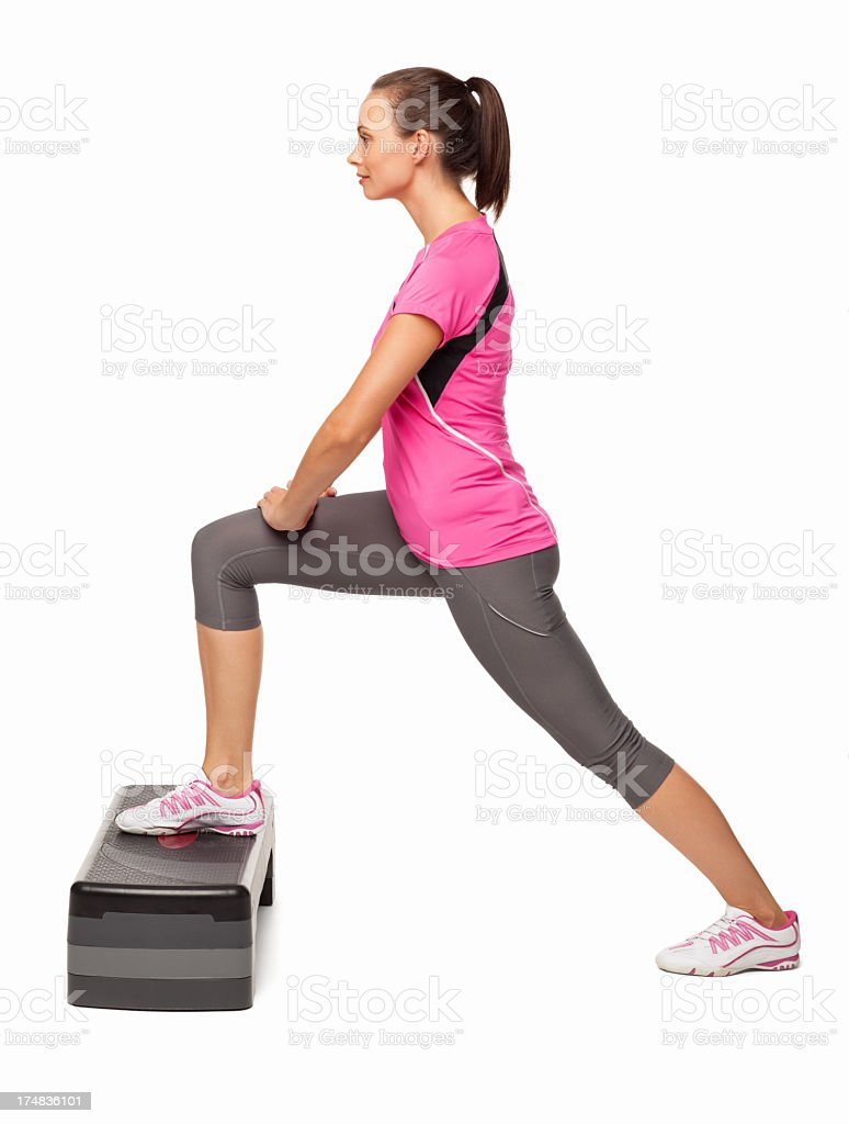 Female Doing Exercise On Stair Stepper - Isolated royalty-free stock photo