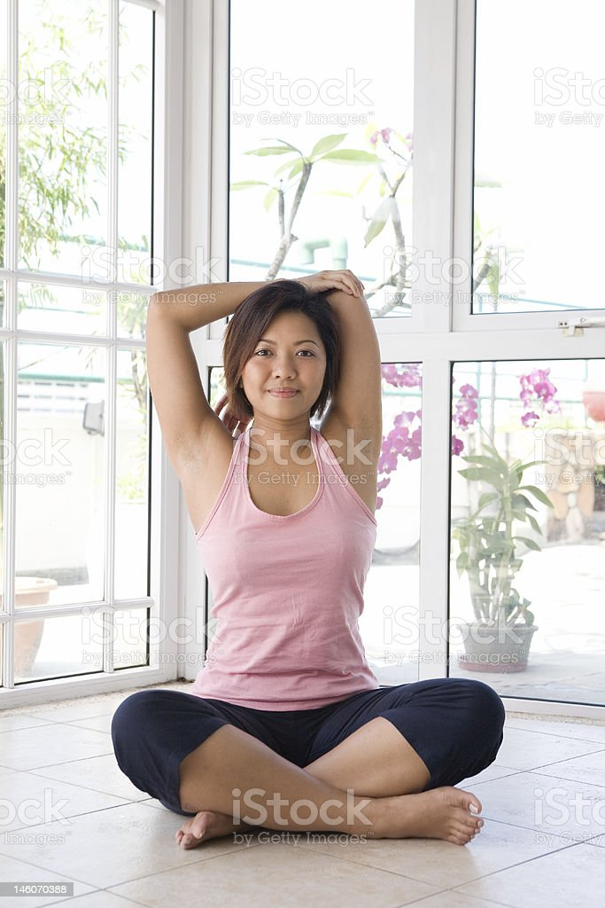 female doing her arm stretching exercise royalty-free stock photo