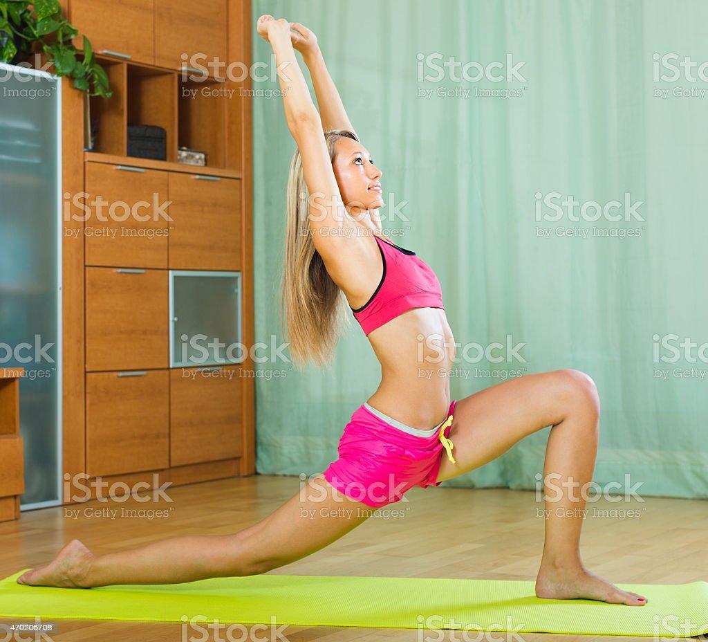 Female doing yoga at home stock photo