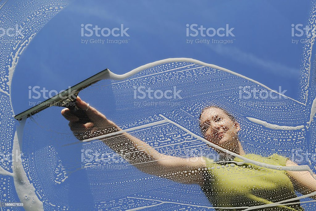 Female domestic Window Cleaner washing stock photo