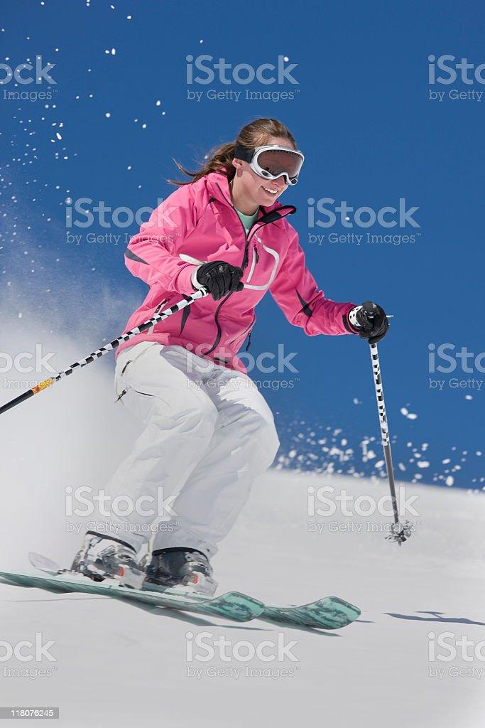 Female Downhill Skier Against Blue Sky royalty-free stock photo