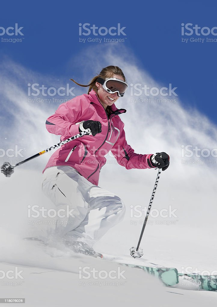 Female Downhill Skier Snowplowing royalty-free stock photo
