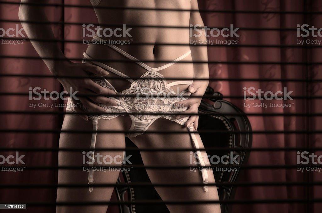 Female dressed in white lingerie stock photo