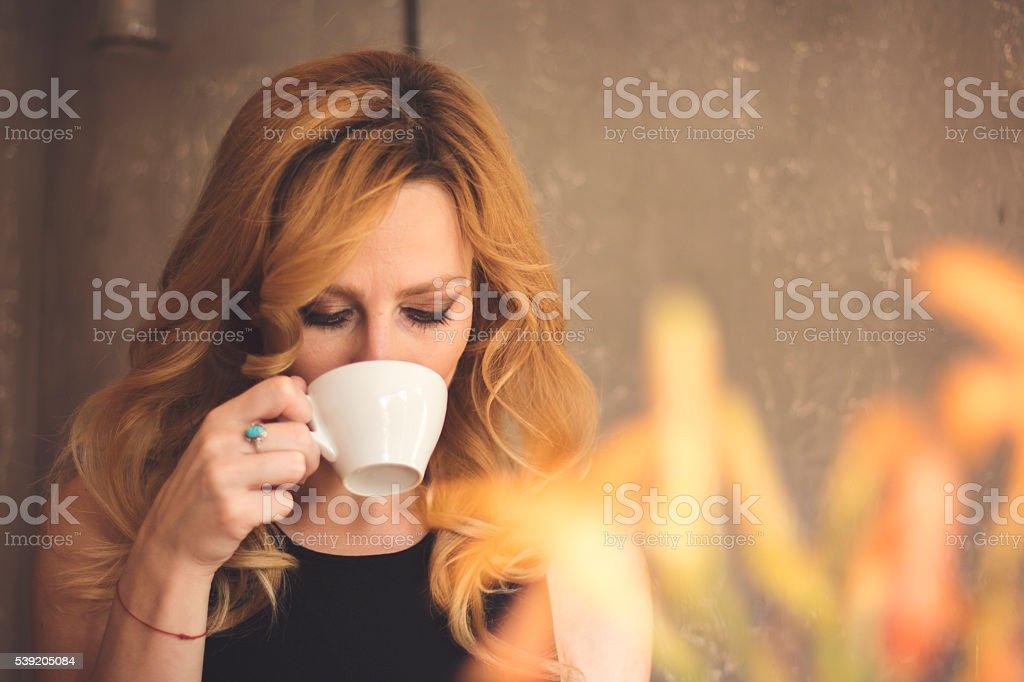 Female Drinking Coffee stock photo