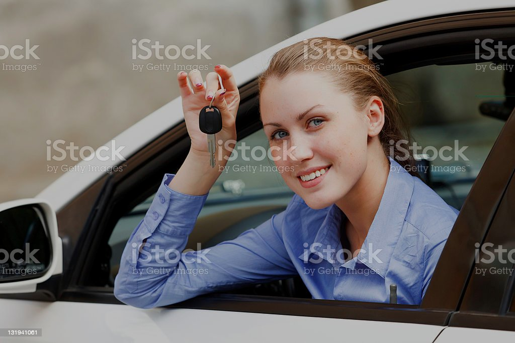 Female driver in a white car royalty-free stock photo