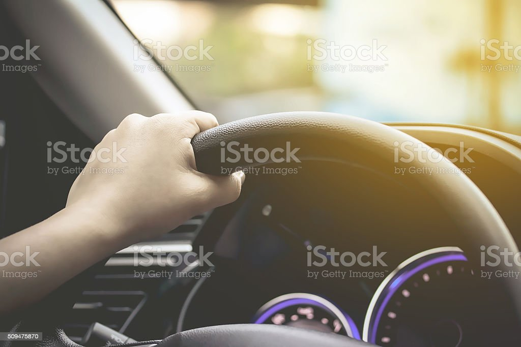 female driving car (left driver) stock photo