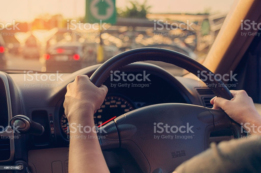 Female driving car. Vintage filter stock photo