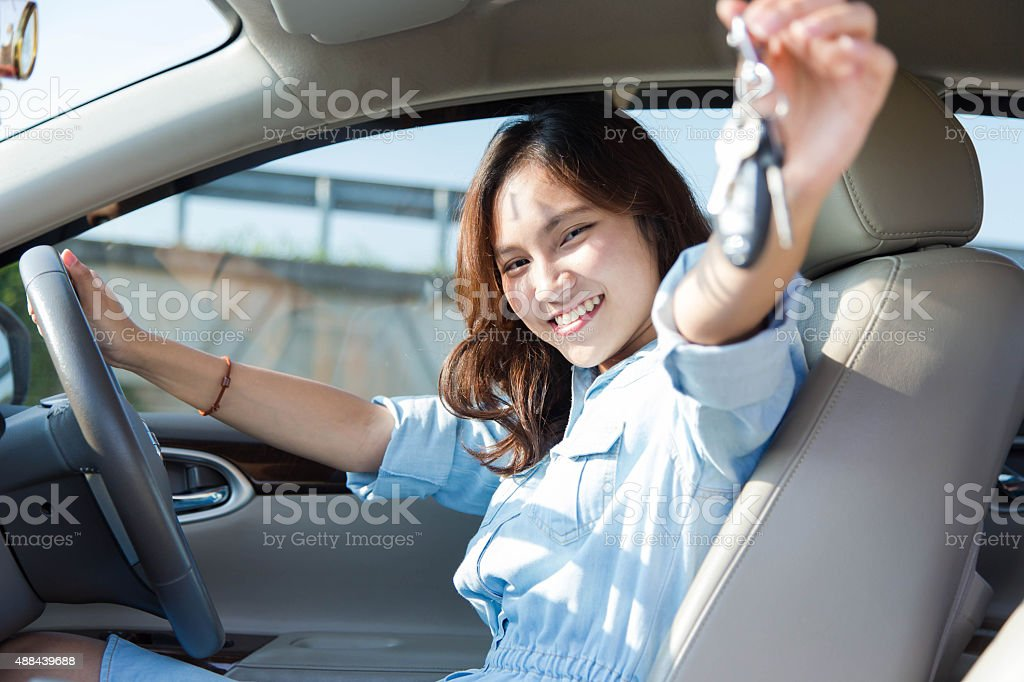 female driving happy about her new car or drivers license stock photo