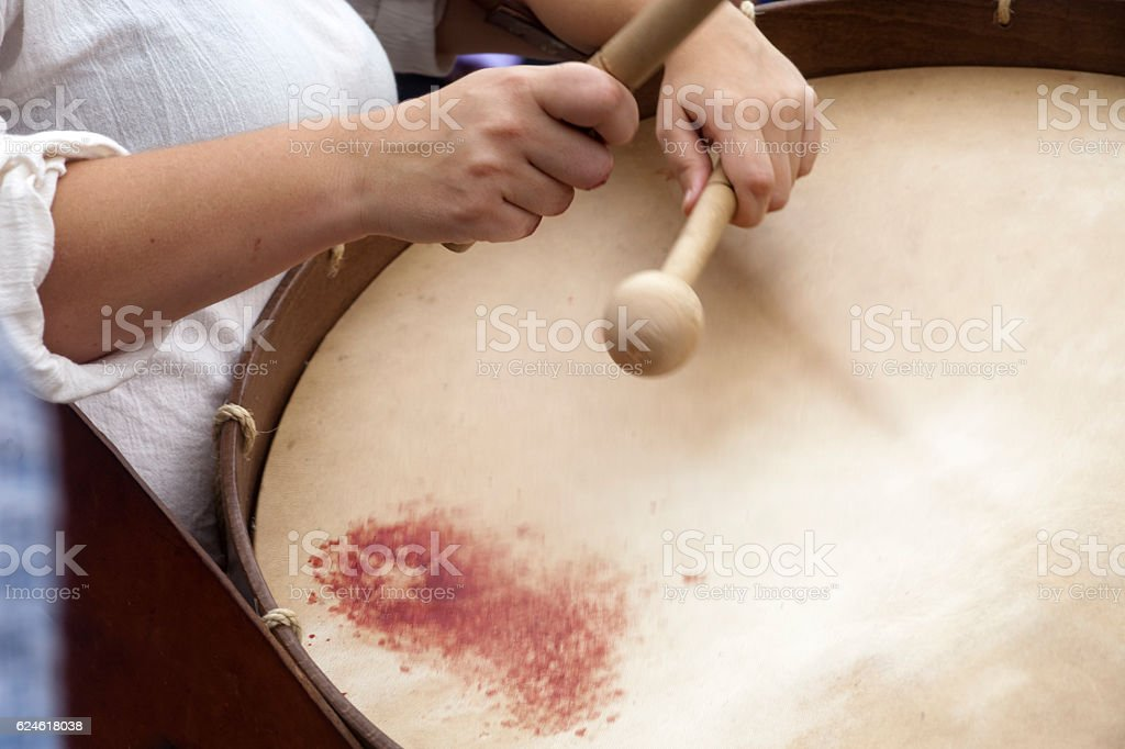 Female drummer in a street band, blood on drum skin stock photo