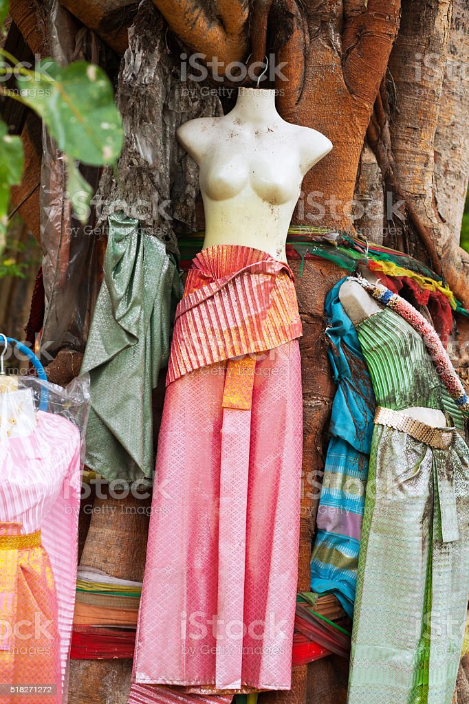 Female dummy and thai skirts at tree stock photo