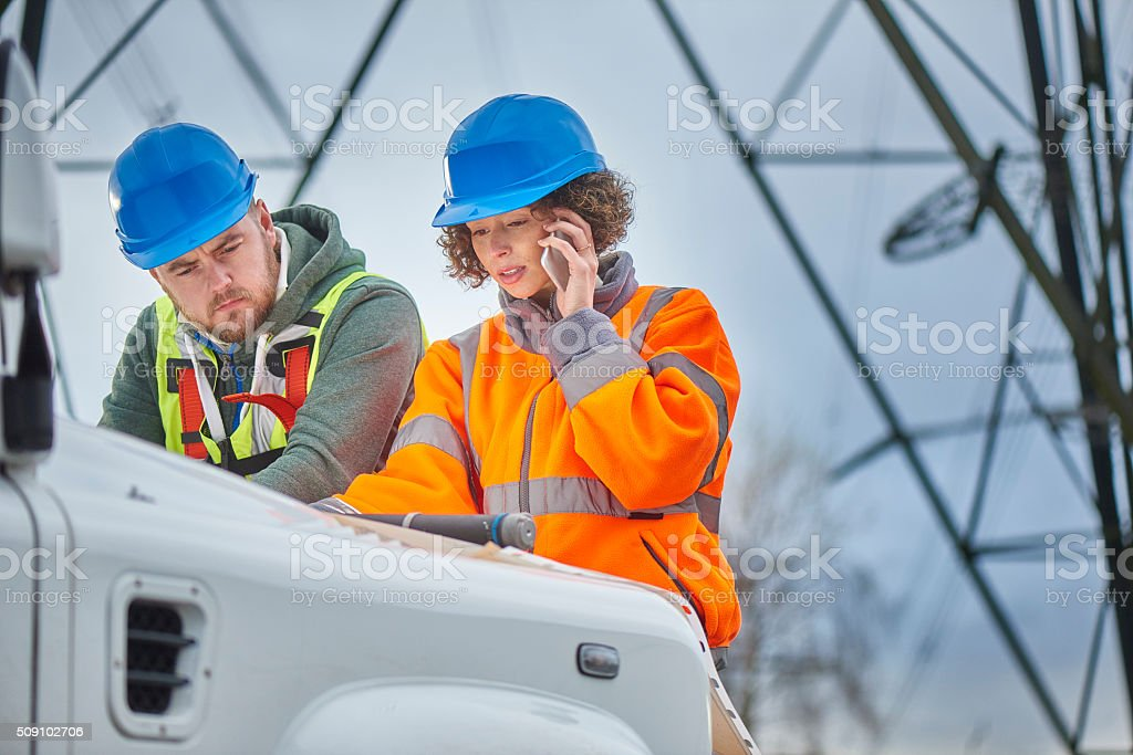 female electricity engineers. stock photo