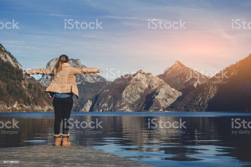 Female embracing nature and feeling carefree stock photo