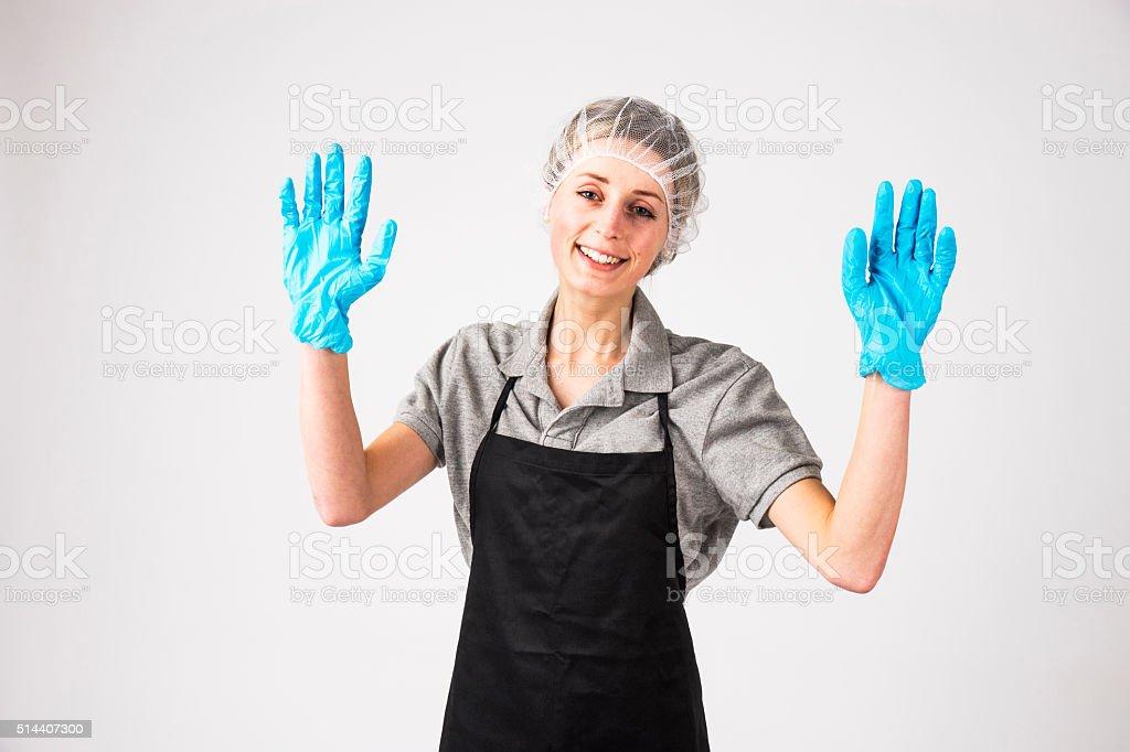 Female employee in uniform wearing a hair net stock photo