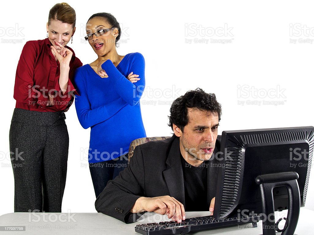 Female Employees Gossiping About a Male Co-Worker stock photo