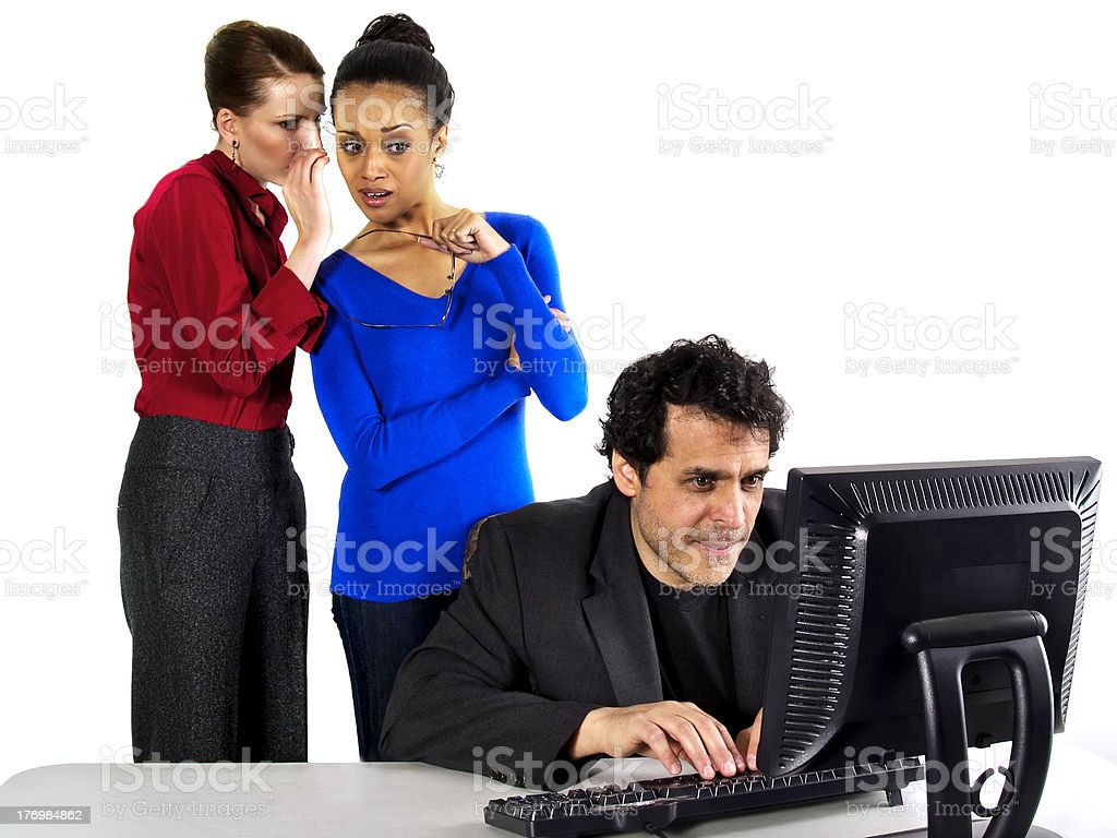 Female Employees Gossiping About a Male Employee stock photo