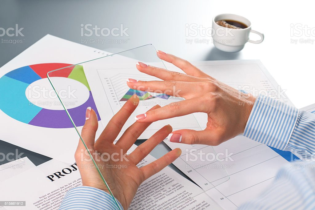 Female employee's hands holding tablet. stock photo