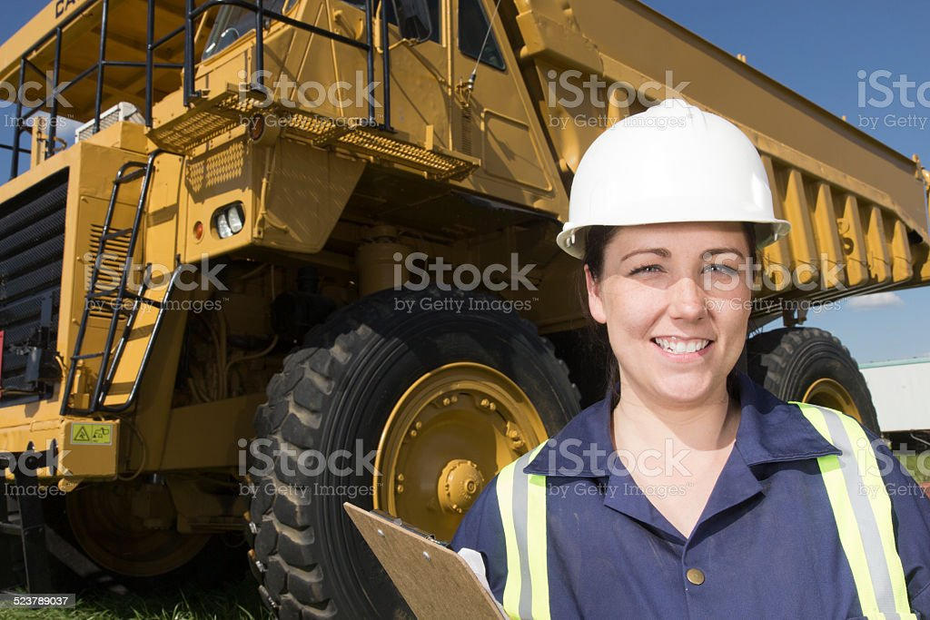Female Engineer and Trucking Industry stock photo