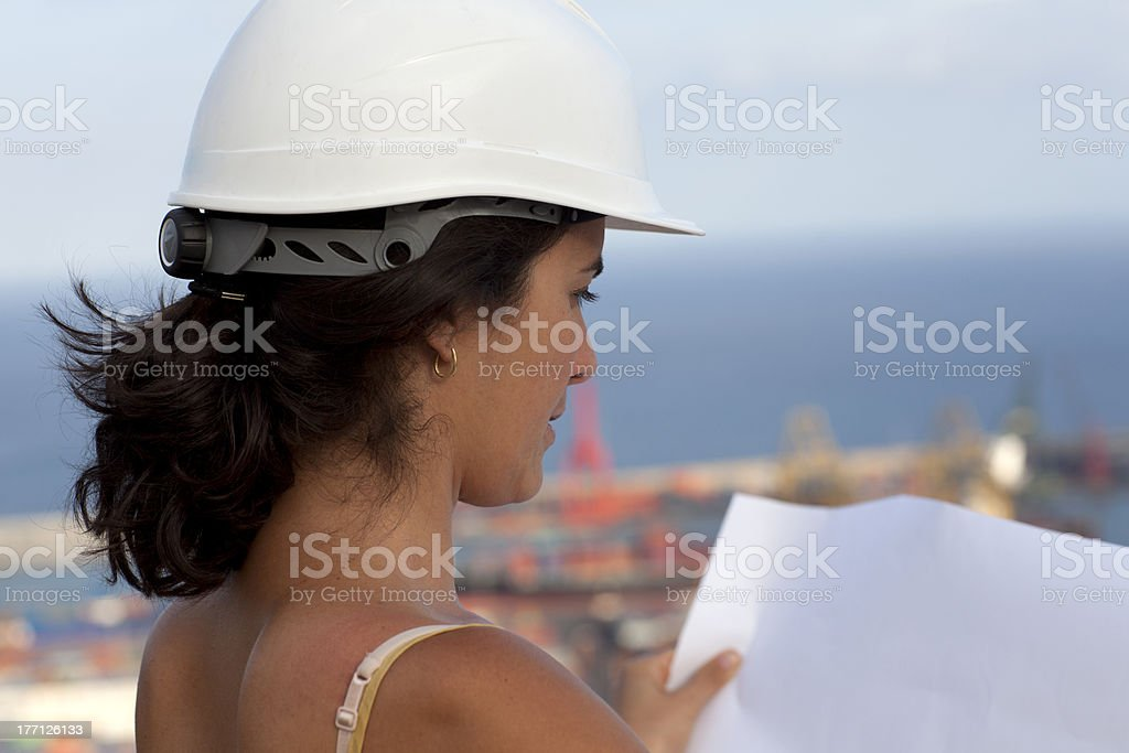 Female engineer checking a plan royalty-free stock photo