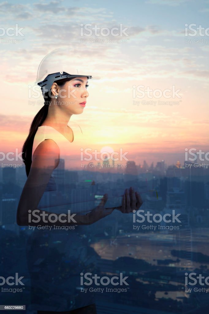 Female engineer holding paper stock photo