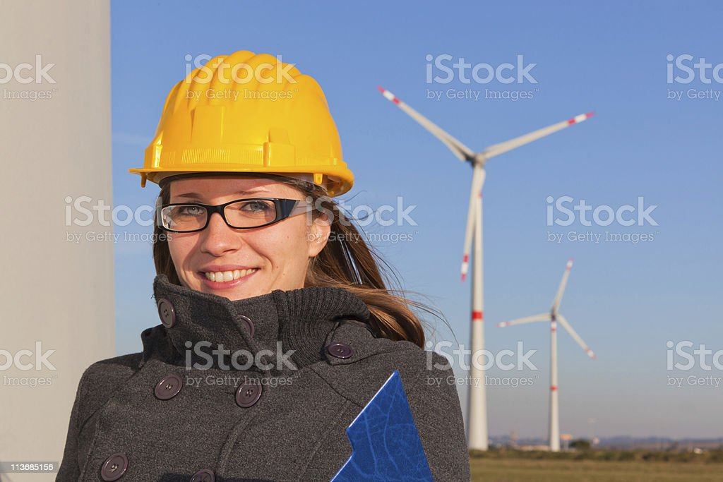 Female Engineer in a Wind Turbine Power Generation Station royalty-free stock photo
