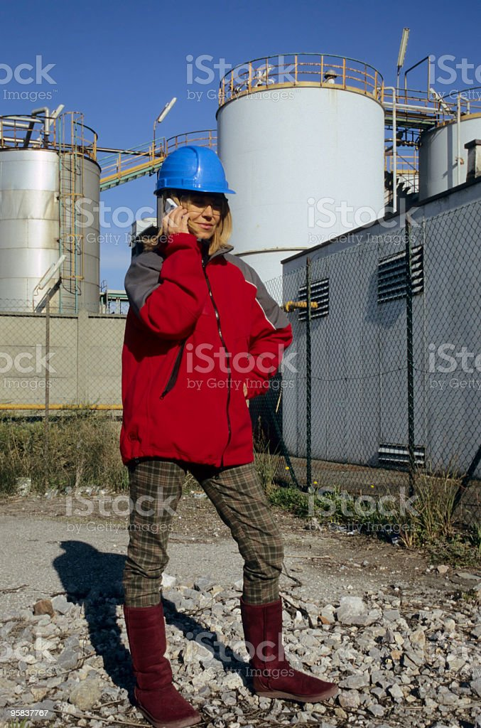 Female Engineer in front of a Chemical Plant royalty-free stock photo