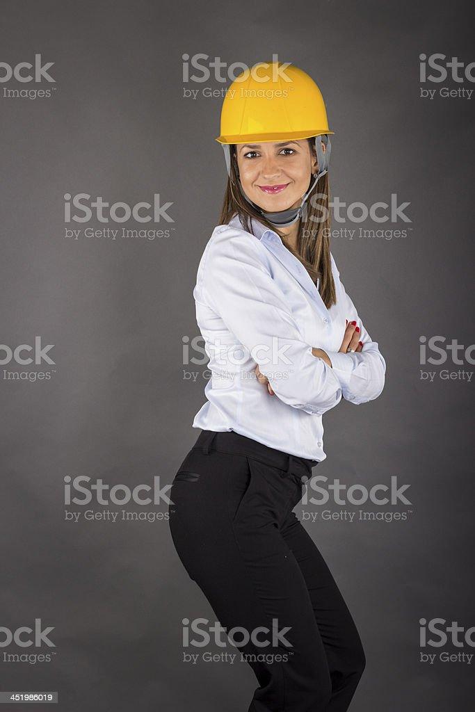 Female Engineer in fullbody wearing yellow helmet stock photo