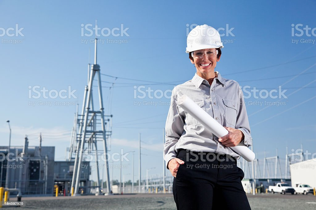 Female engineer in parking lot of power station royalty-free stock photo