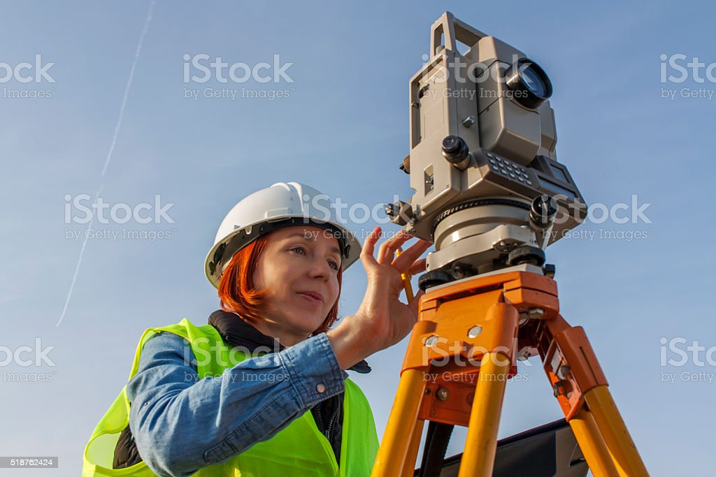 Female engineer land surveyor stock photo