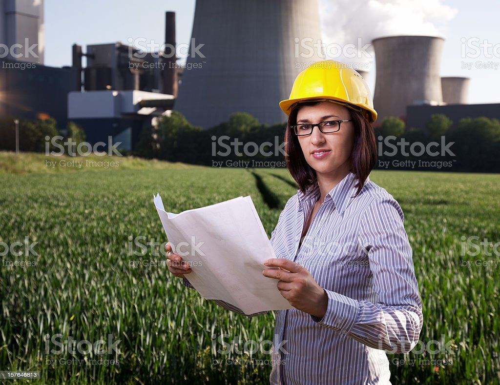Female engineer reading plans royalty-free stock photo