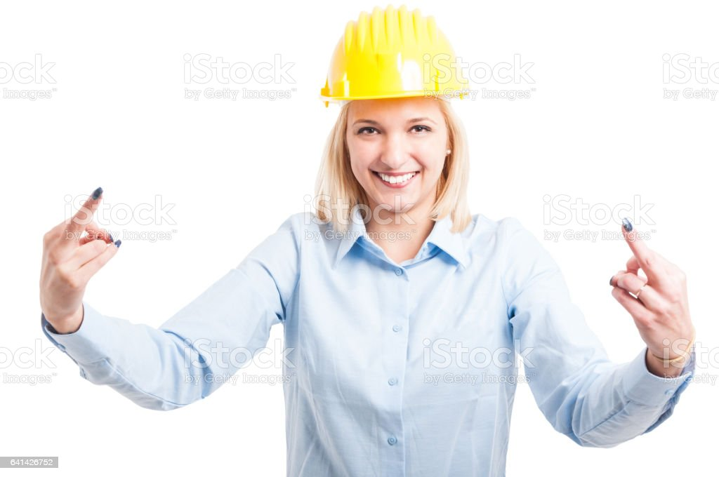 Female engineer showing obscene gesture with both hands stock photo