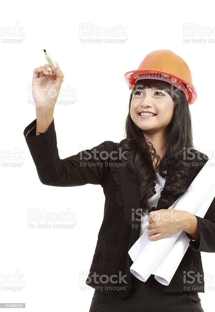 Female engineer with a pen writing royalty-free stock photo
