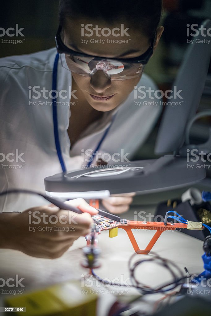 Female engineer working on drone stock photo
