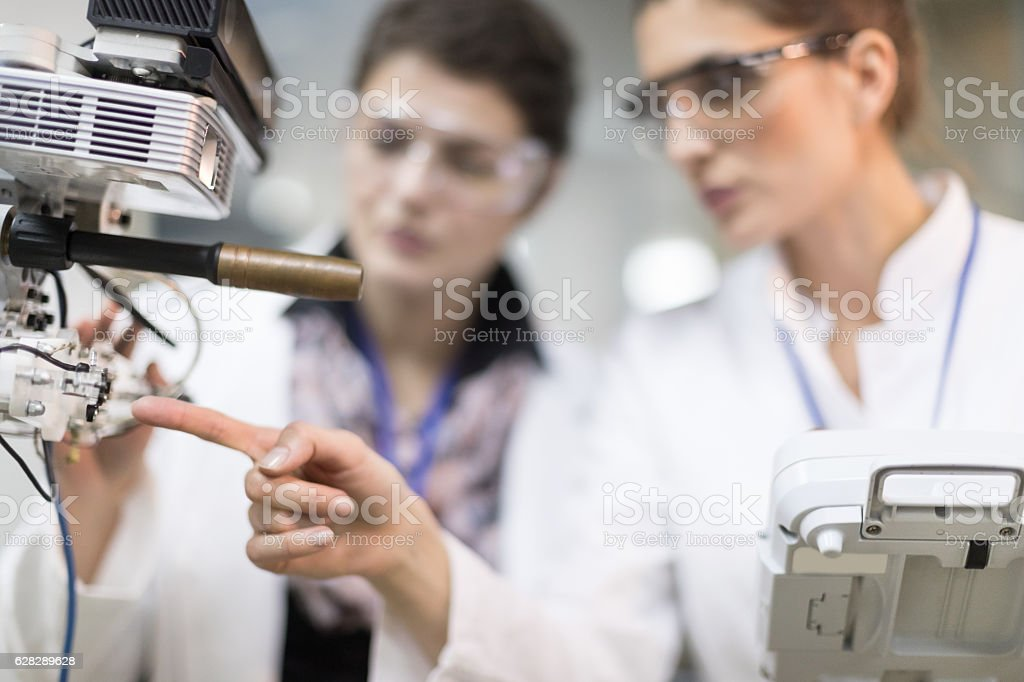 Female engineers working in research lab stock photo