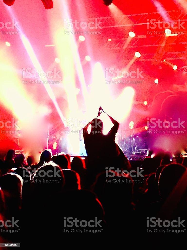 Female enjoying the concert stock photo