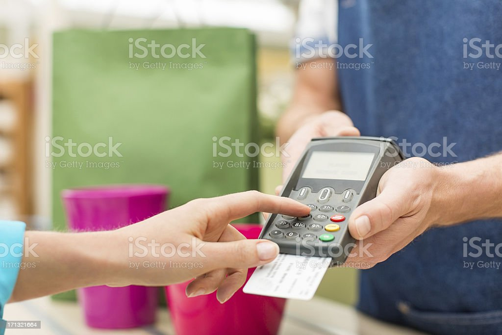 Female Entering PIN Number In Credit Card Reader stock photo