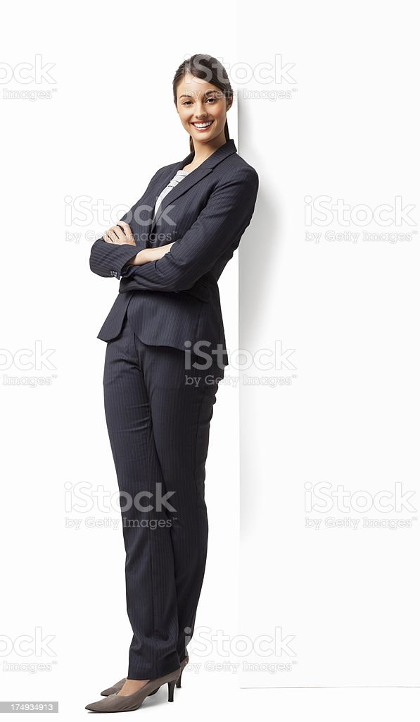 Female Entrepreneur Standing Hands Folded - Isolated royalty-free stock photo