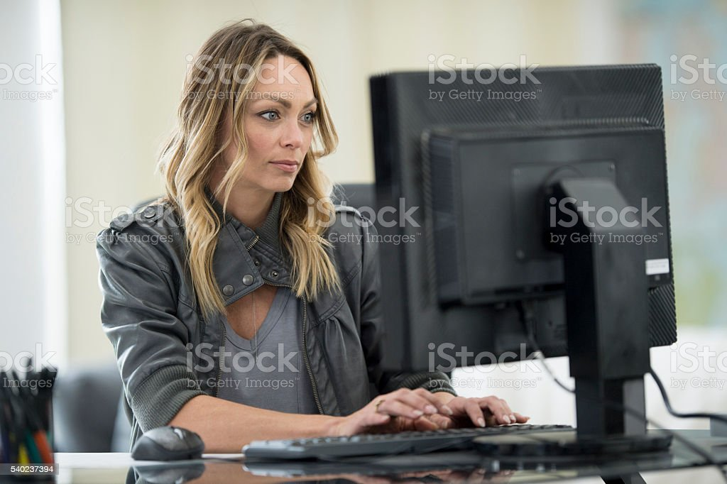Female Entrepreneur Working From Home stock photo