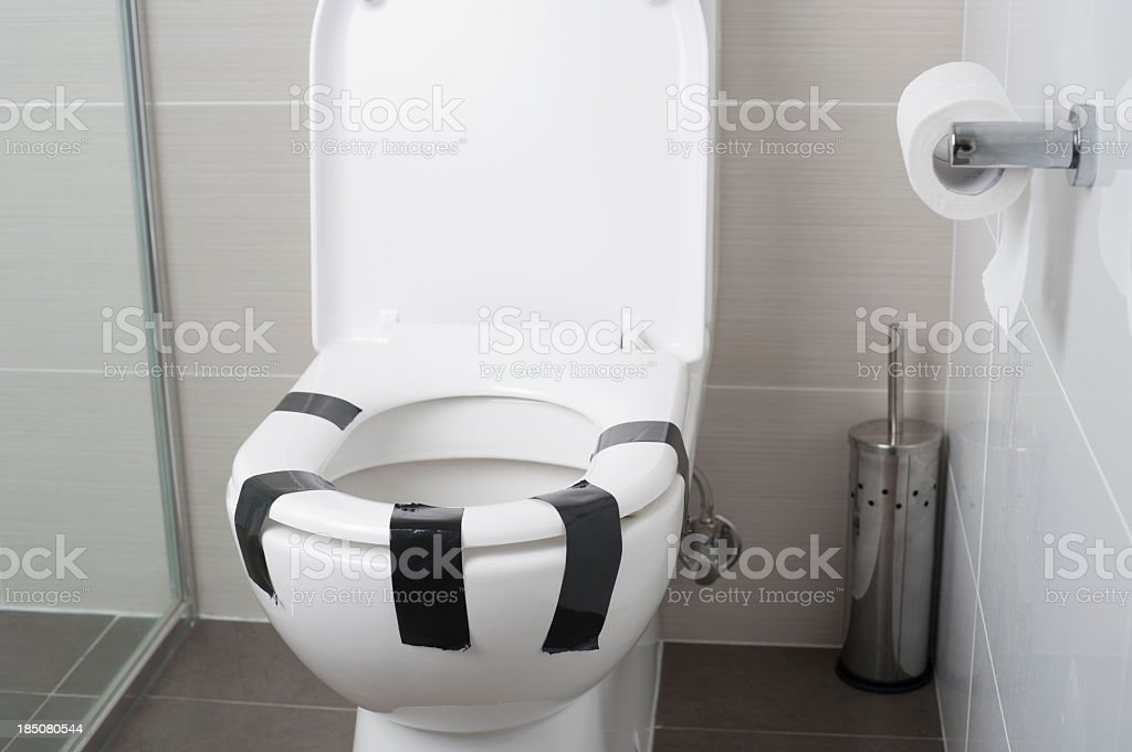 Female equality concept. Toilet seat taped down stock photo
