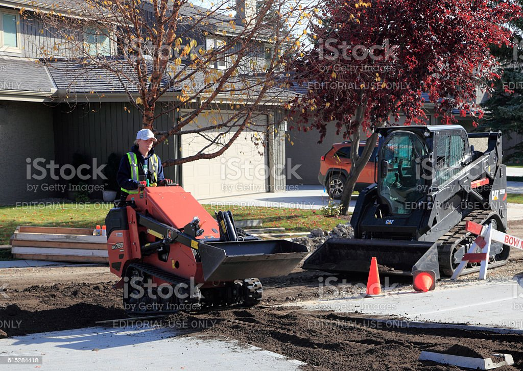 Female Equipment Operator At Residential Construction Site stock photo