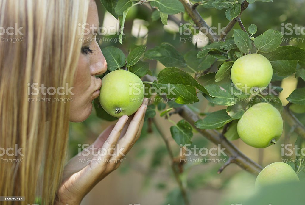Female Eve being tempted by an apple