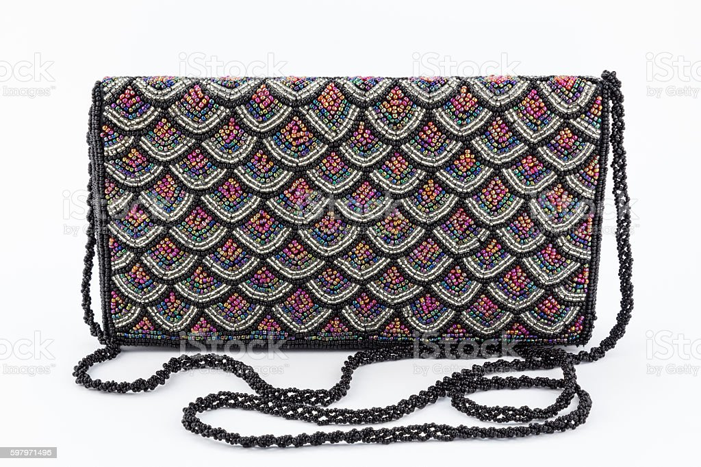 Female evening clutch embroidered with black beads stock photo
