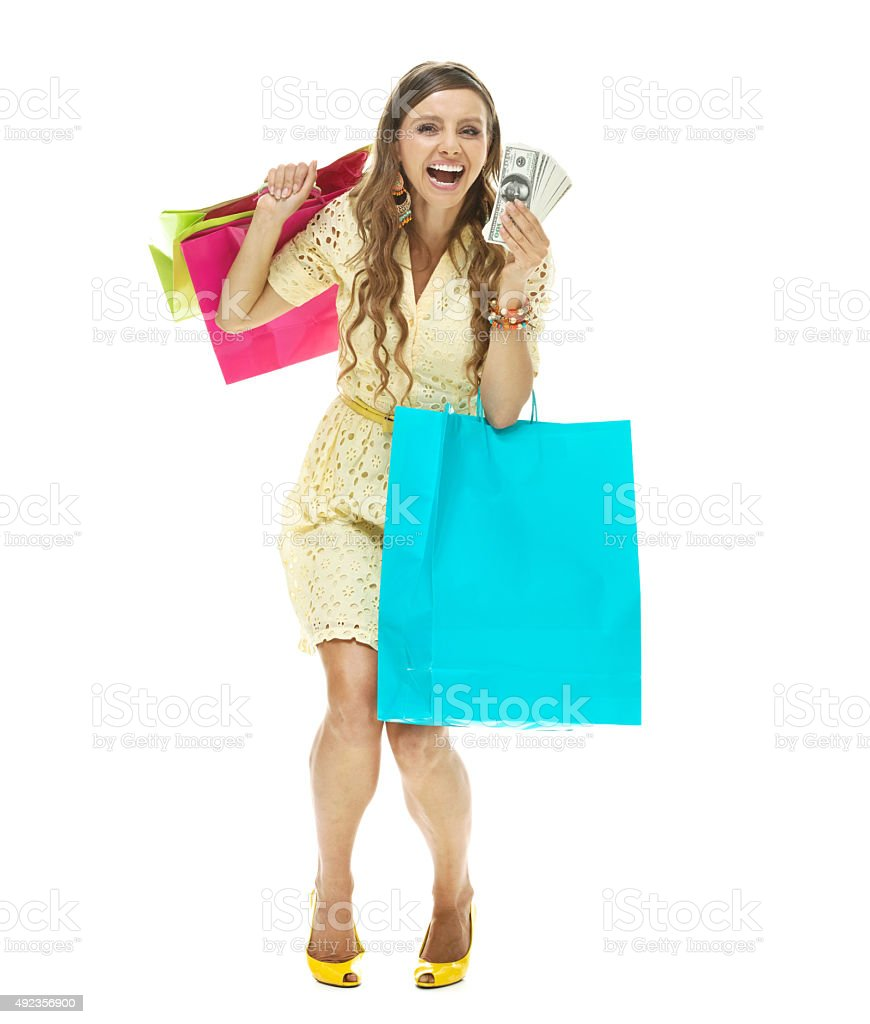 Female excited by all the money she has for shopping stock photo