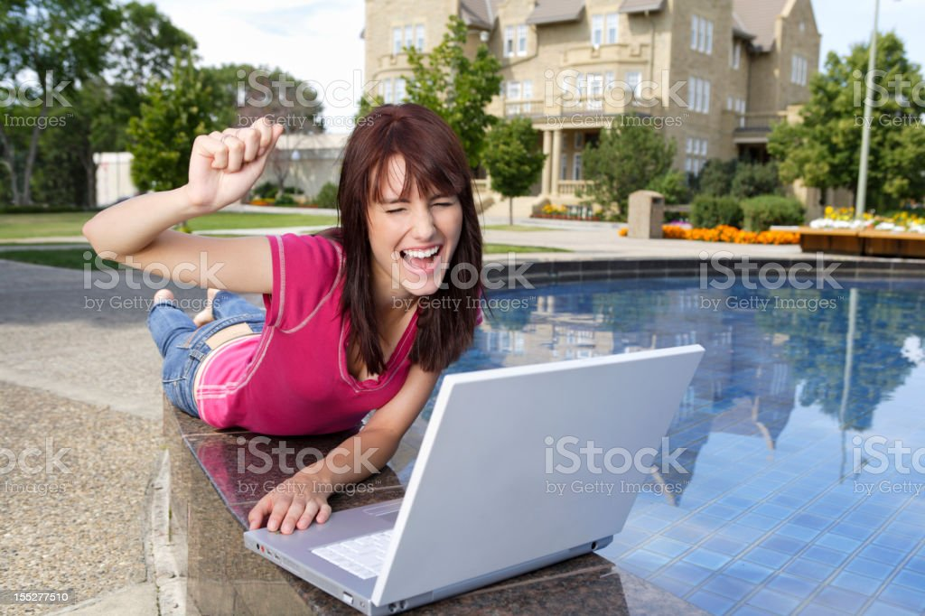 Female excited to surf the internet royalty-free stock photo