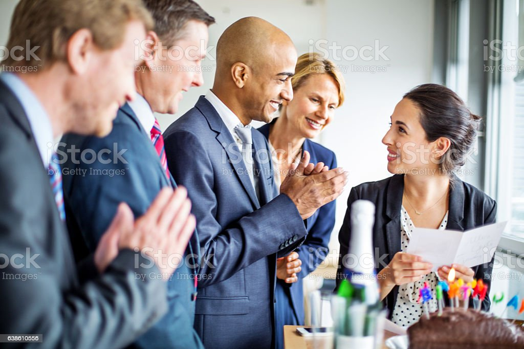 Female executive celebrating birthday in office stock photo