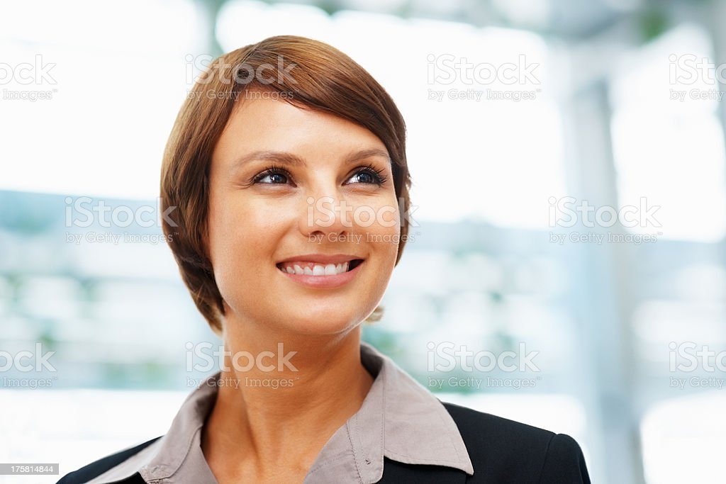 Female executive daydreaming stock photo
